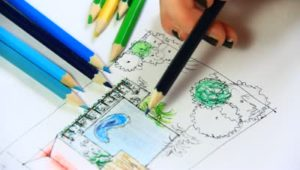 stock-footage-woman-landscape-architect-working-on-new-project-in-her-office-drawing-sketching-explaining-her-1